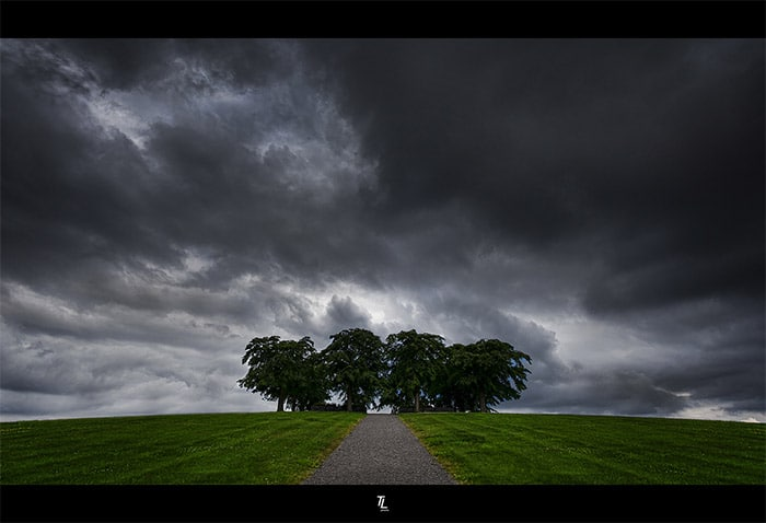 Storm clouds can add interest to a composition. Photo: The Pathway by Tobias Lindman